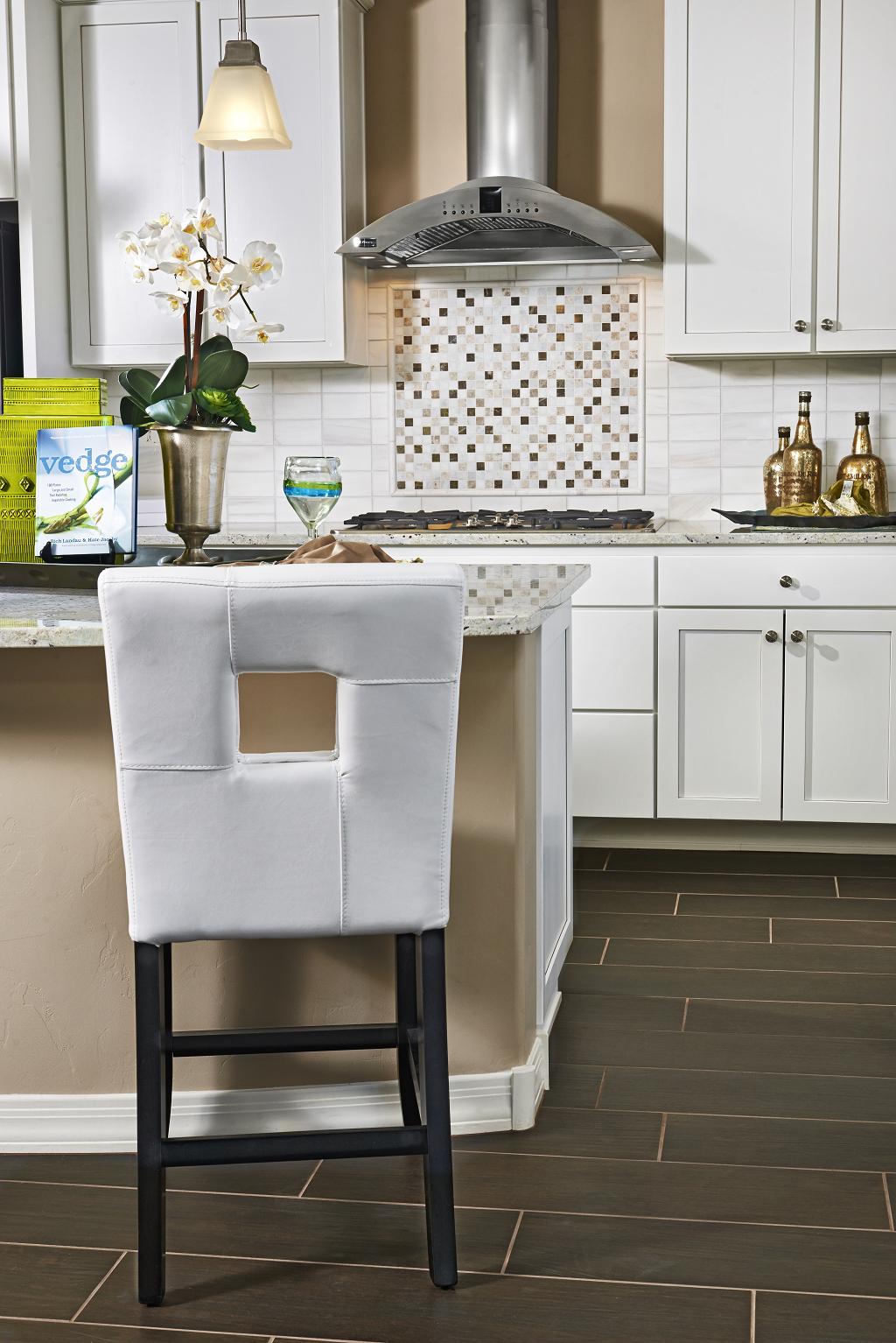 Thomas model home kitchen with white cabinets, tile backsplash ...