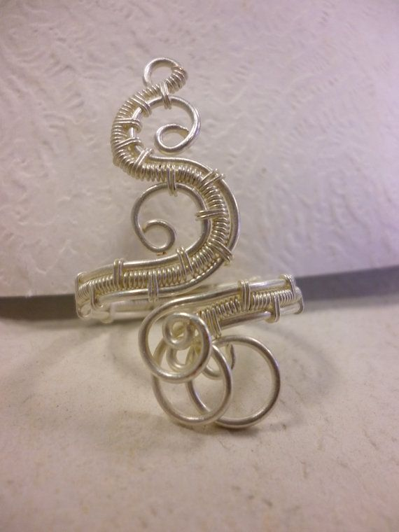 Spiral ring wire jewelry by Juditta on Etsy, $20.00  possibly do diff. colors ex. gold, silver & bronze or 2 blk & 1 blue...