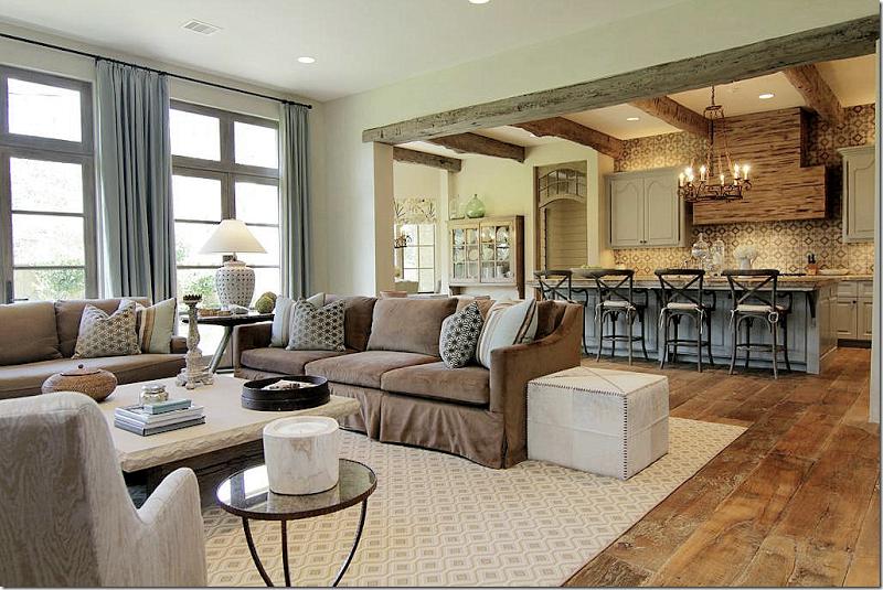 Great open concept! Love that wood floor.   Brown living ...