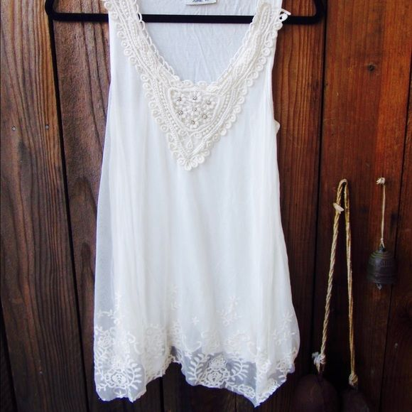 Brand New! Free People inspired top! Brand new sleeveless top by June K. Has diamonds & lace crochet detail around the neck & along the bottom. Never worn! Reminds me of Free People. LOVE this top!  Tops Blouses