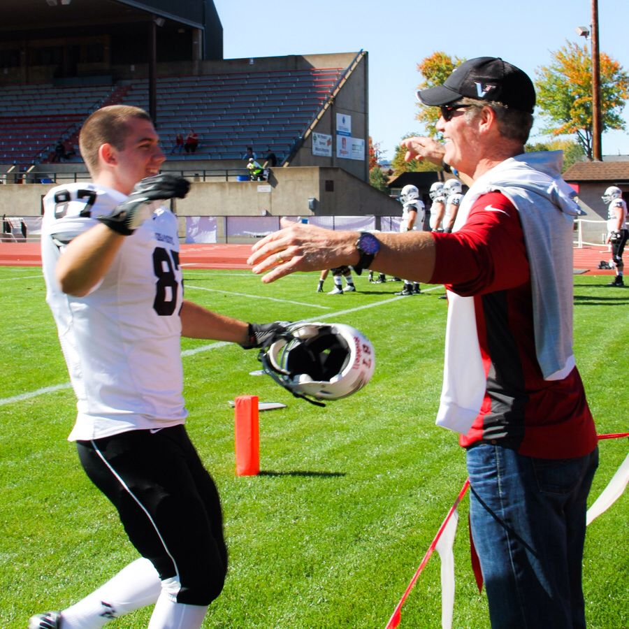 One of the best candid photos I've ever taken...my youngest son and husband reconnect on the football field after two months away at college! Pure love and joy....