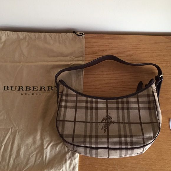 Authentic vintage Burberry purse I have two of Burberry purses and only 1 dustbag at the moment. I'll provide the dustbag  with the purse that sells first. Inside zipper works. Clean. A little wrinkled from storage. Sold as is. All sales are final. Burberry Bags