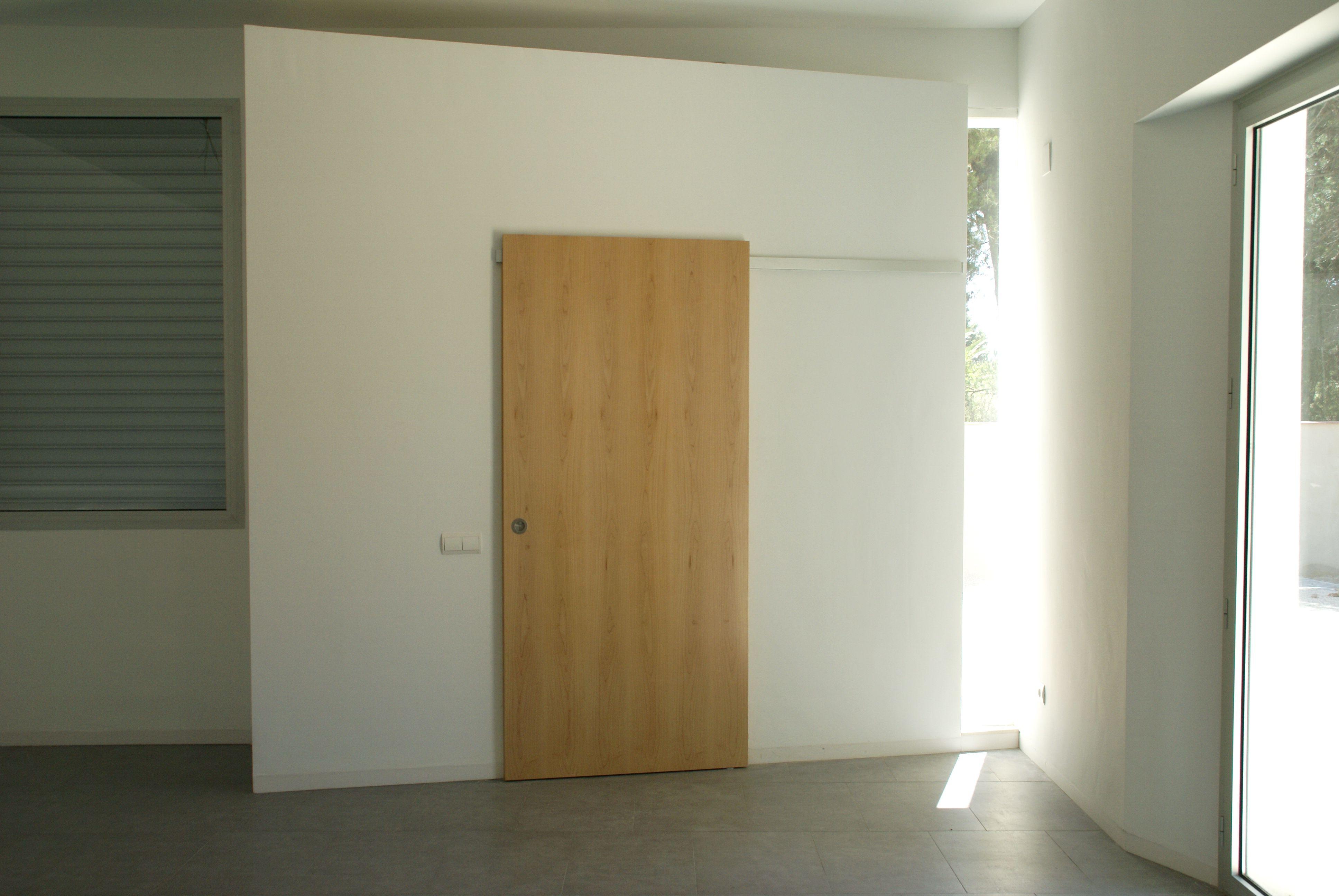 Puerta corredera por pared sistema de herraje oculto - Sistema puerta corredera ...
