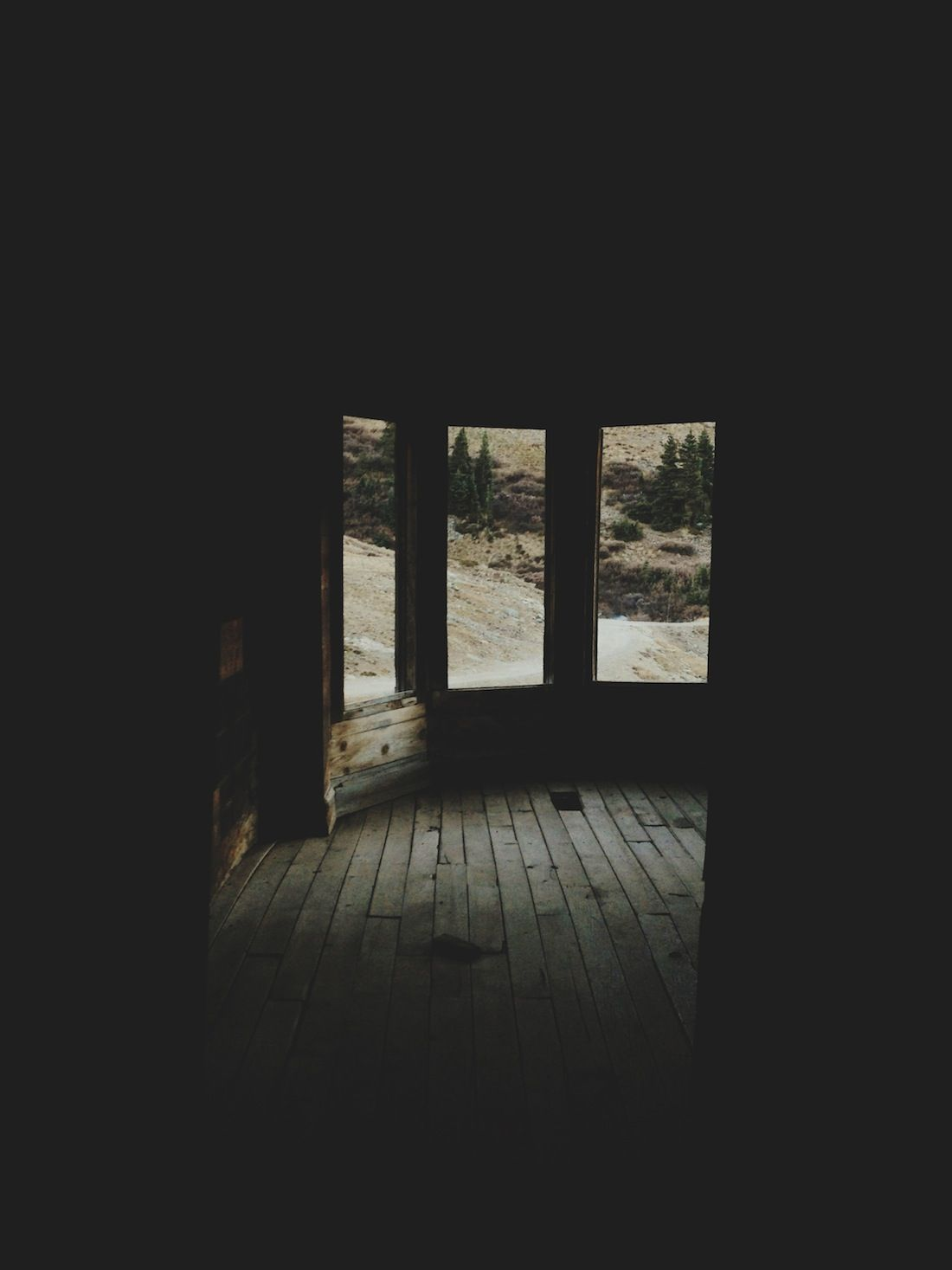 Dark empty room with window - House