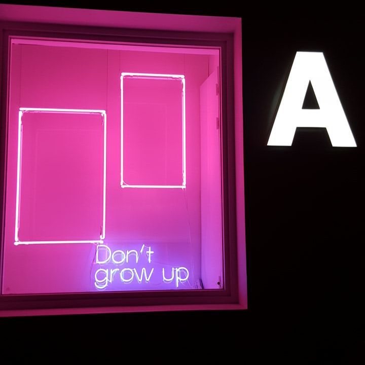 Don't grow up' Neon sign in Ader Error Showroom | Neon Signs