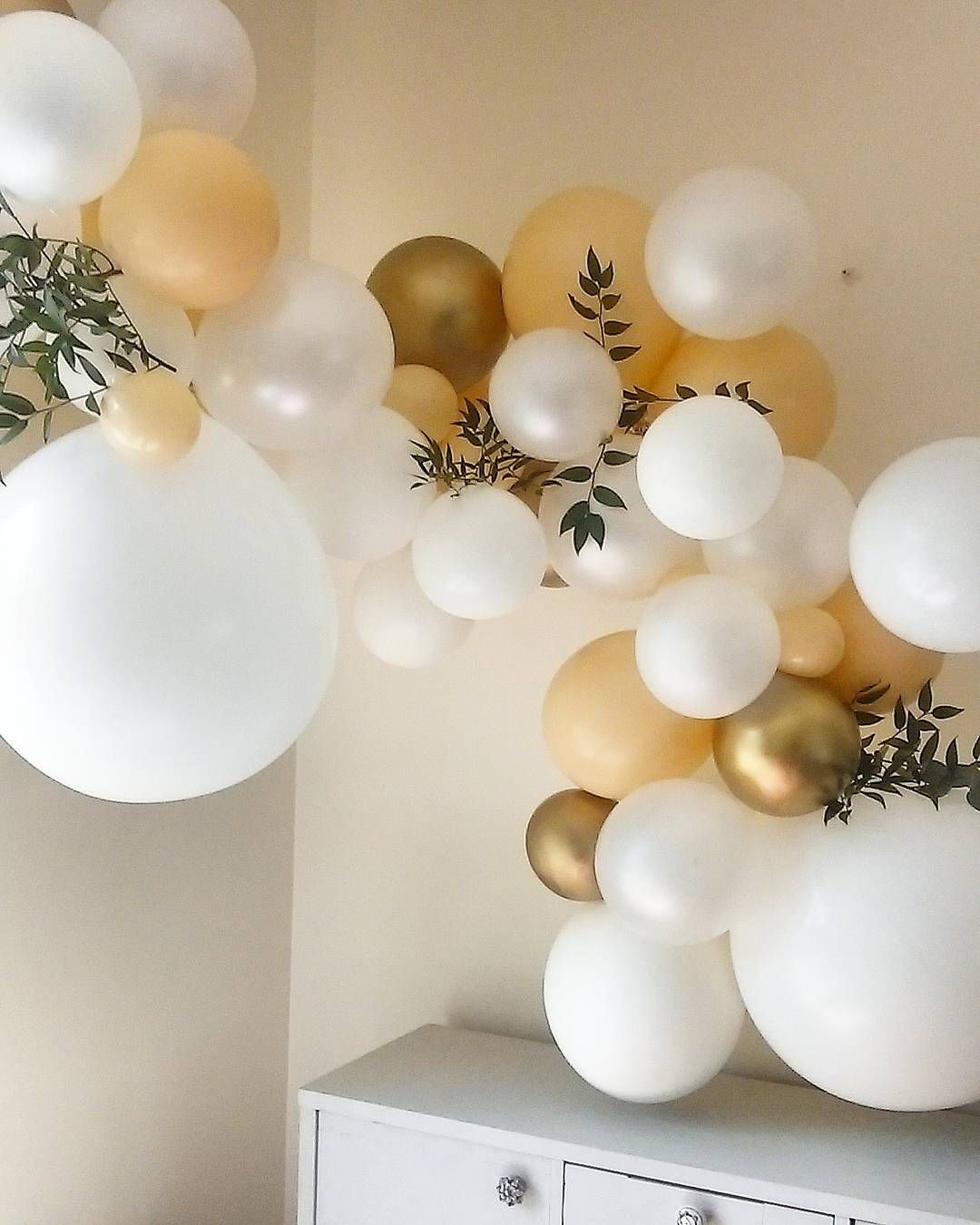 Organic balloon arch making a huge statement with metallic