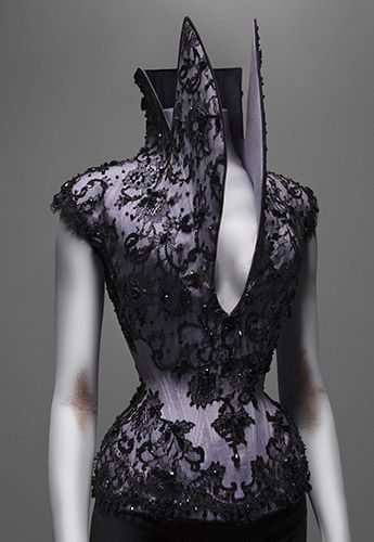 Alexander McQueen (British, 1969–2010). Corset Dante, autumn/winter 1996–97. Lilac silk faille appliquéd with black silk lace and embroidered with jet beads. Courtesy of Alexander McQueen. Photography by Sølve Sundsbø - http://elogedelart.canalblog.com/archives/2011/05/03/21046691.html