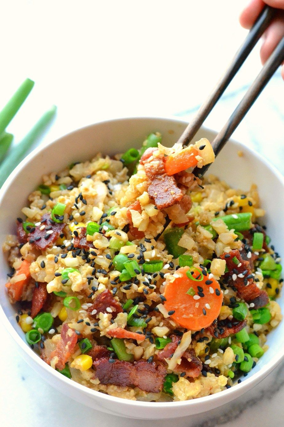 This recipe for Cauliflower Fried Rice is a perfectly delicious, healthy, and fast alternative for traditional fried rice!