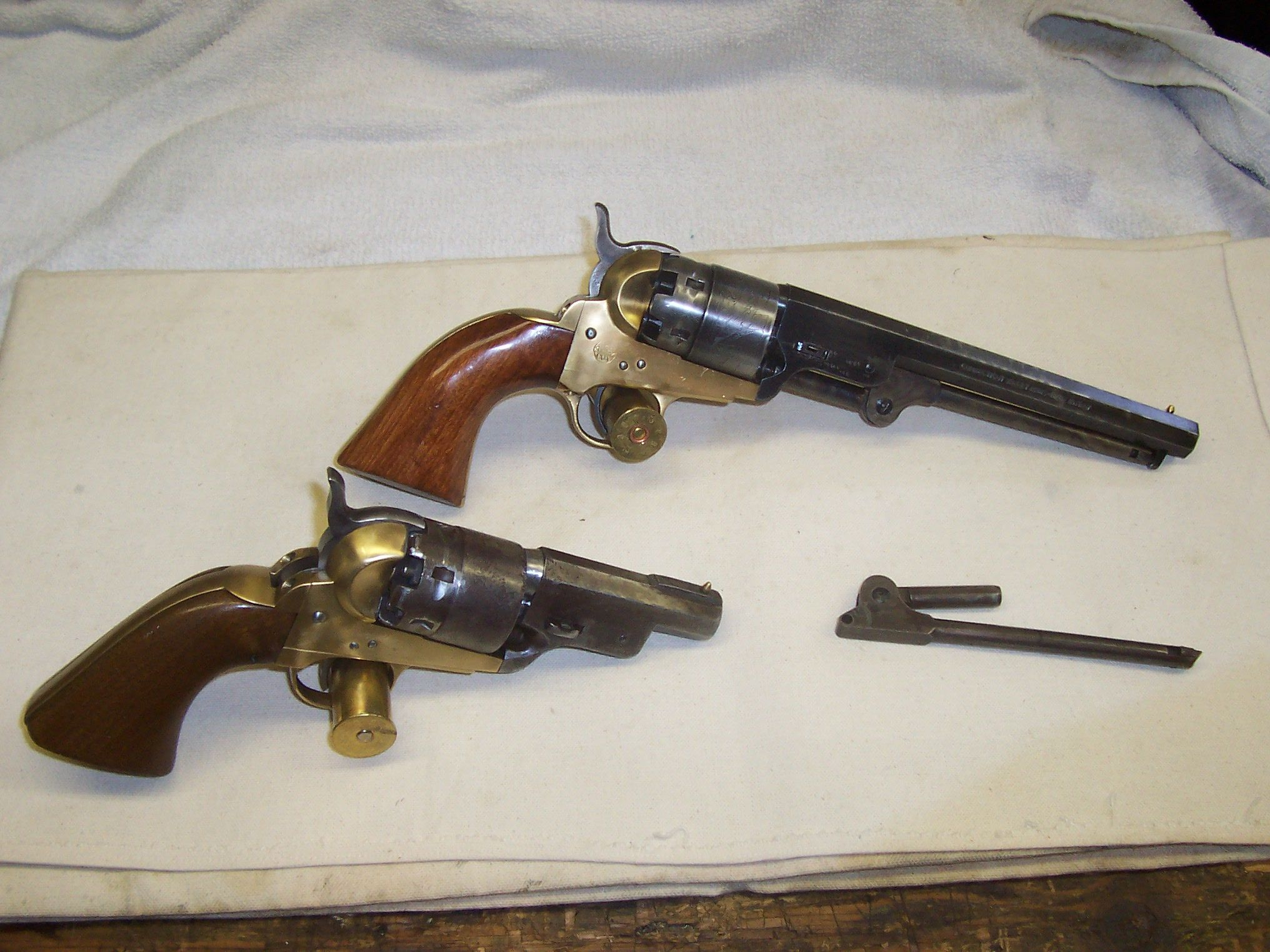 One Shortened 1851 Colt .44 cal. and another unmodified