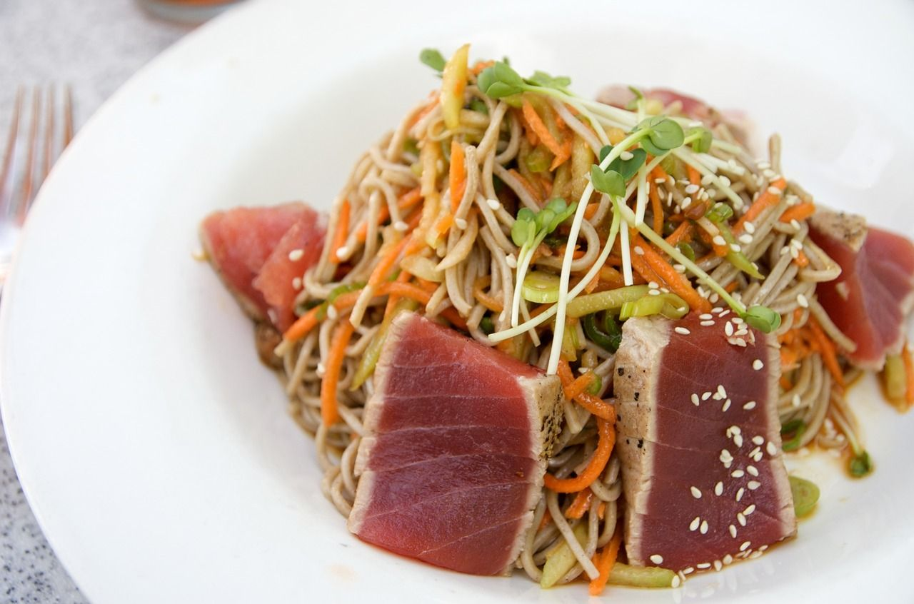 seared rare ahi, chilled japanese soba noodle salad with ginger-soy vinaigrette at george's at the cove ocean terrace in downtown la jolla.