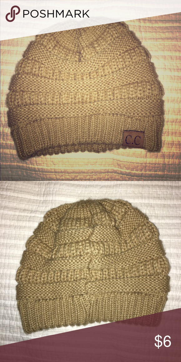 8e50e0c11de C.C tan beanie Worn only once! Great condition and super cute! crane  clothing Accessories Hats