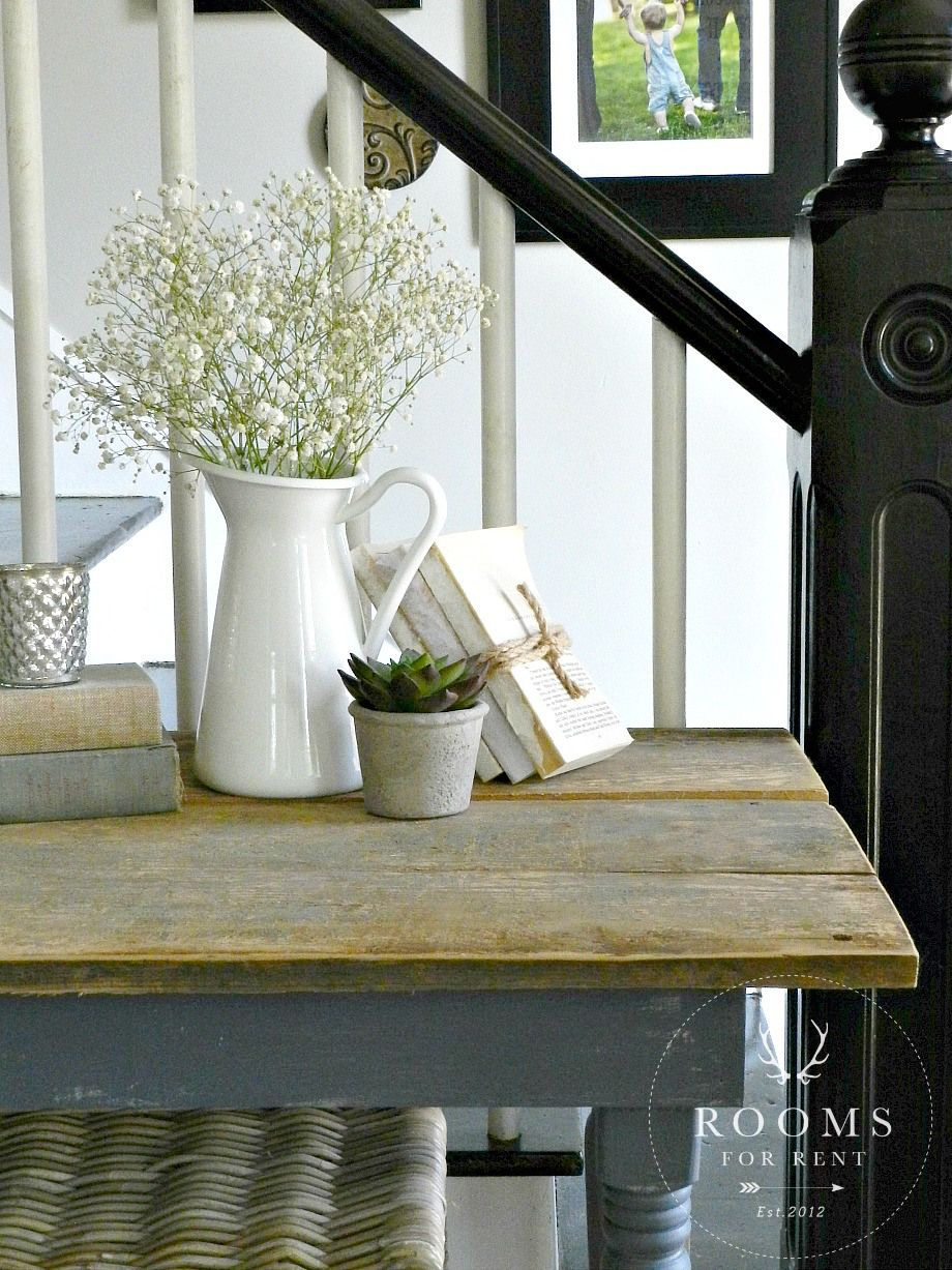 Vignette simple farmhouse decor staples white pitchers old books weathered wood
