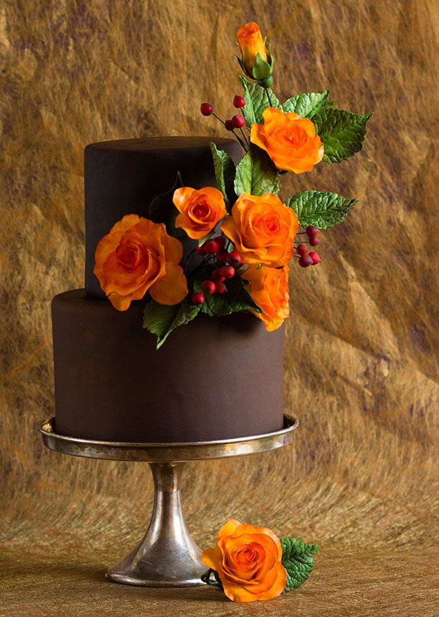 Imagine a chocolate cake with Ganache inside and out with beautiful silk flowers. So beautiful