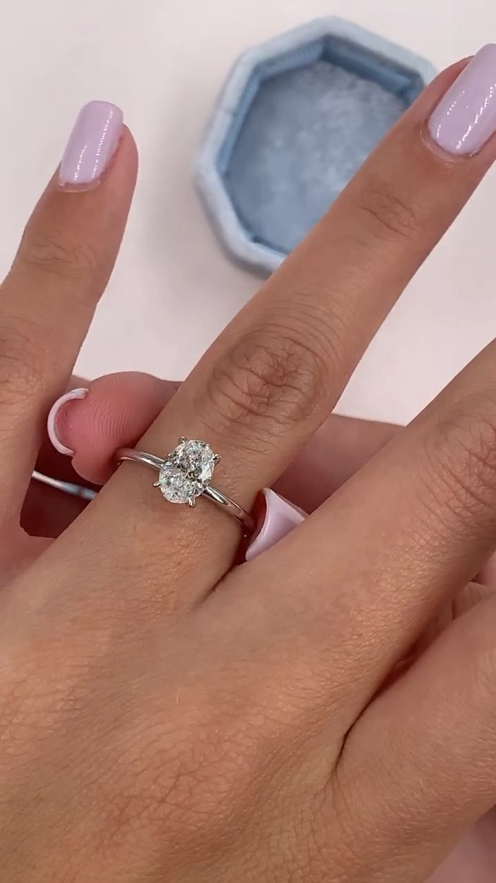 Solitaire oval diamond engagement ring