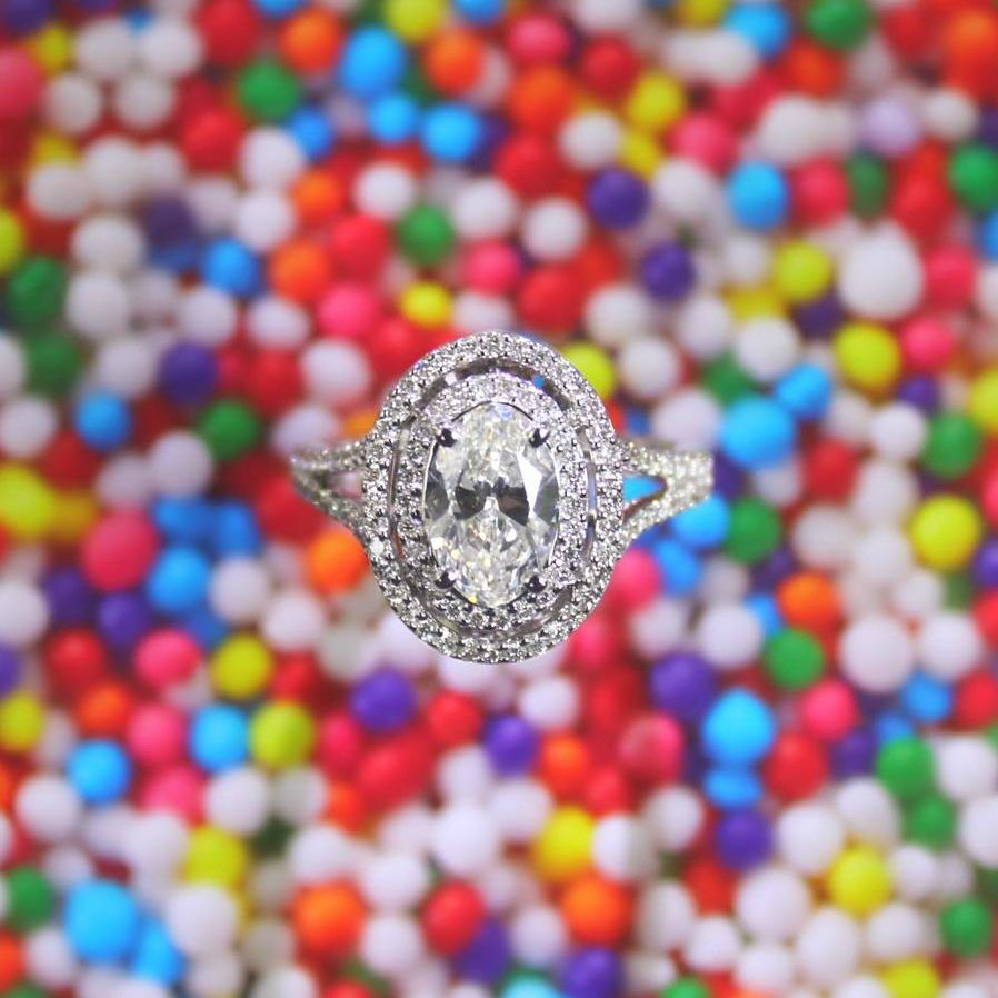 Oval cut diamond surrounded by a double halo of sparkle ...