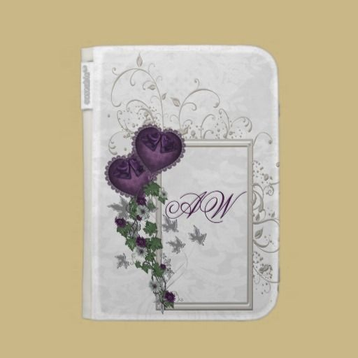 Elegant Ivy and Purple hearts A classy white patterned background, a frame with three-dimensional swirls, ivy vines with purple flowers and two purple damask hearts. Customize the text with your initials or your name. Designed for Amazon Kindle Keyboard 3rd generation, Water-resistant fabric wrapped hardcover exterior with elastic strap closure, Suede interior with document pocket and elastic device corners straps.