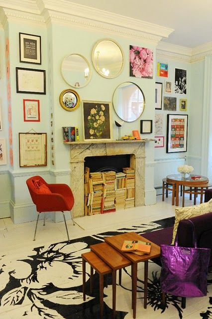 What a creative way to dress up a blank wall & fireplace mantel ...