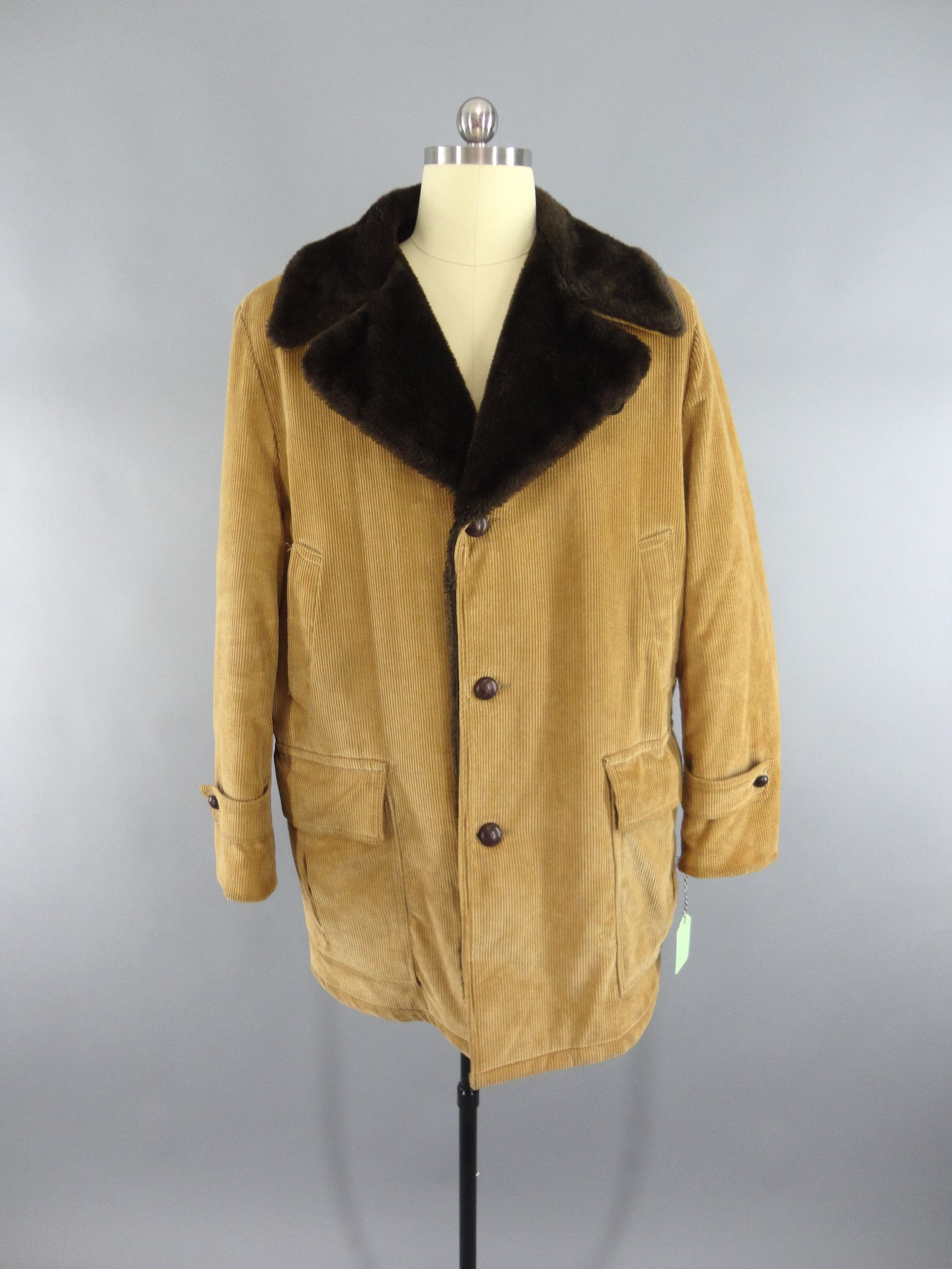 088d152d0c8e Great vintage men s fall coat. Tan corduroy with dark brown faux fur  lining. Button front and flap pockets. The back of the tag has someone s  initials and a ...