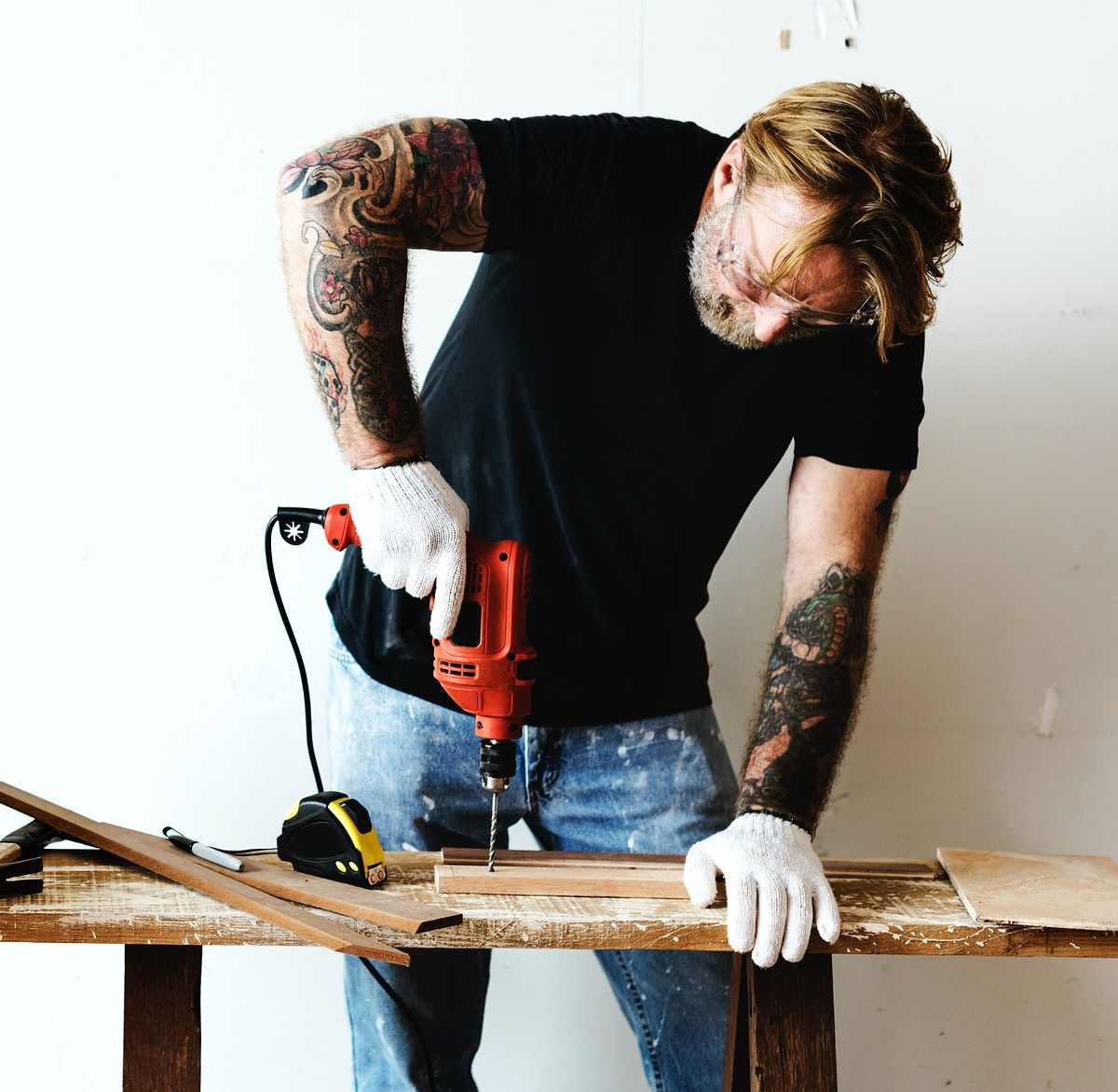 Download Premium Image Of Constractor Handyman Working And Using