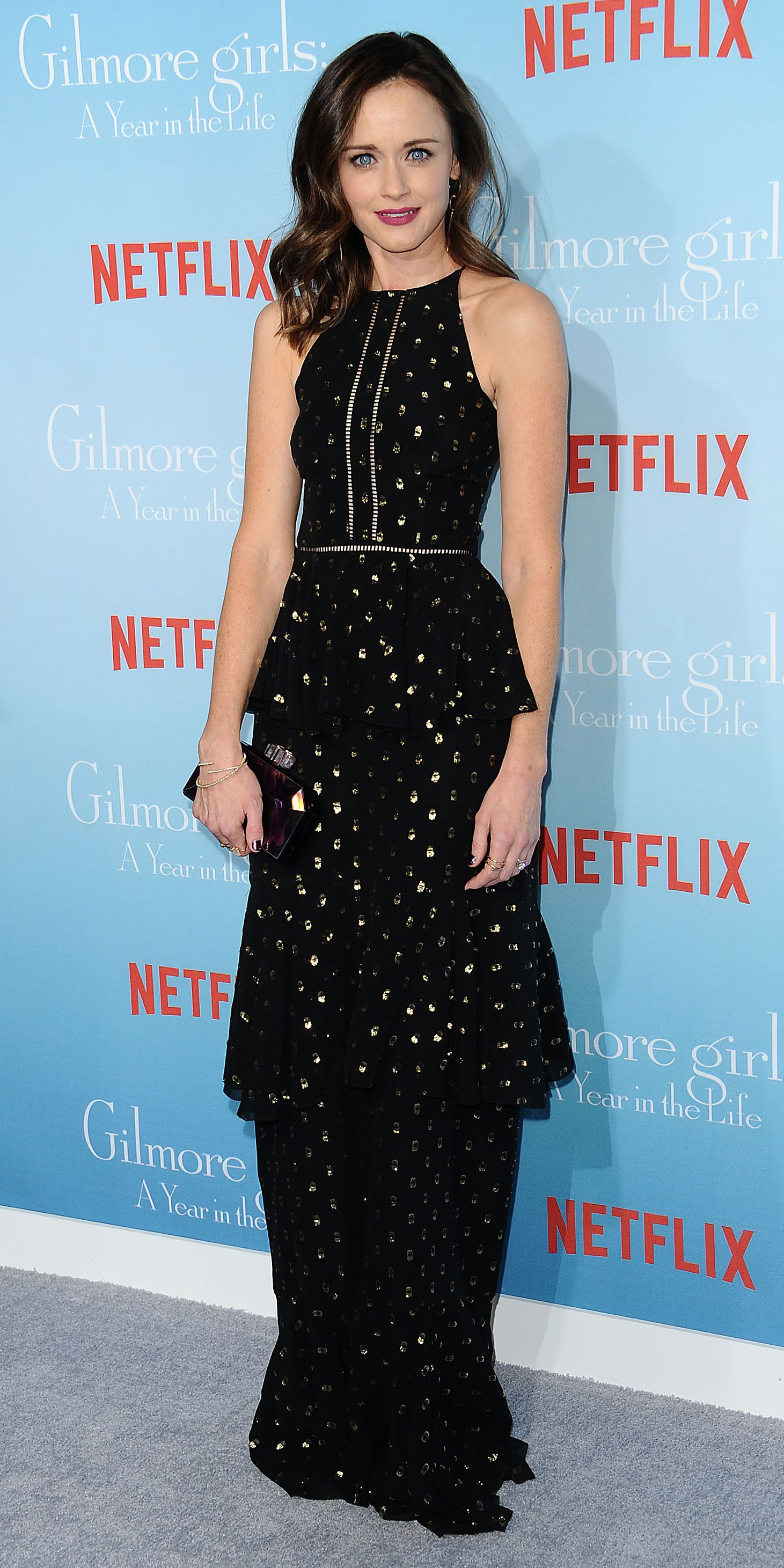 Rory is all grown up! Alexis Bledel hit the premiere of Netflix's Gilmore Girls: A Year in the Life in a gold polka-dot ruffled Cynthia Rowley gown , styled with a Judith Leiber clutch, a selection of jewelry by Paige Novick, Bowen, Tara 4779, and Gillian Steinhardt, and Stuart Weitzman sandals.