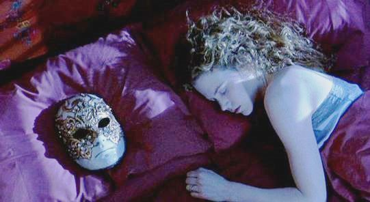 A Woman Sleeps On Her Bed A Mask Lies On The Pillow -9955