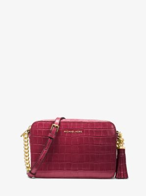 488503267 The Ginny crossbody strikes the perfect balance between understated and luxe,  with a lightly structured and compact design that's rendered in  croc-embossed ...