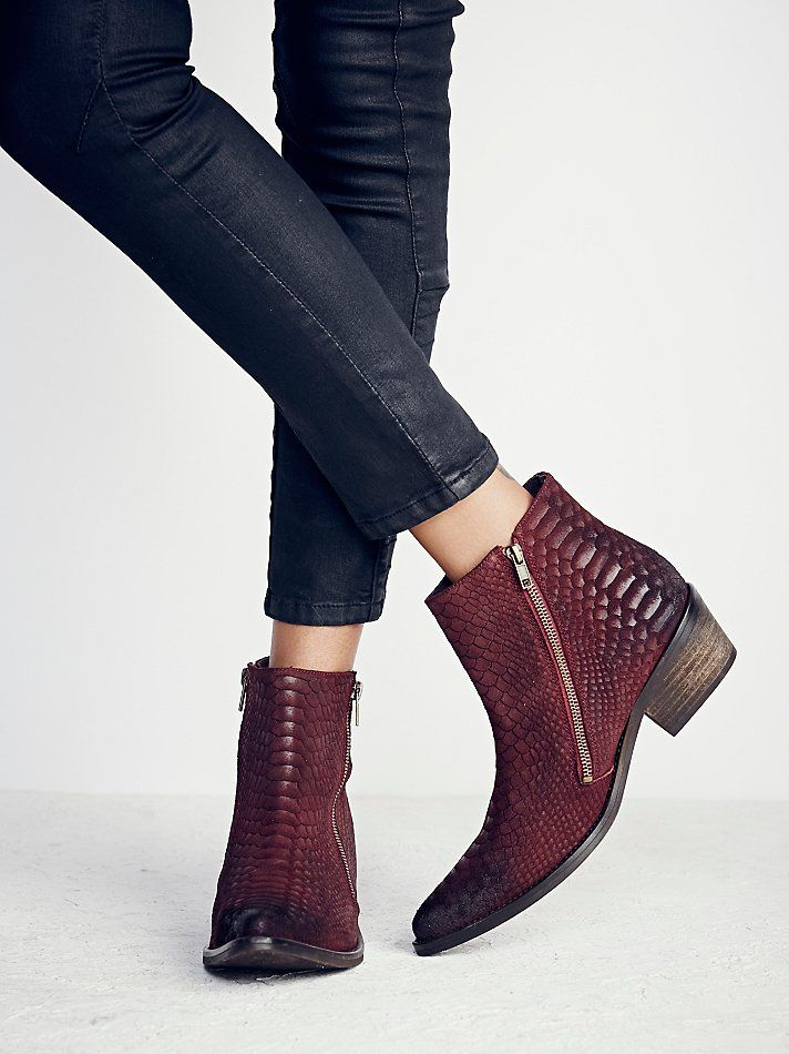 Crossings Ankle Boot | Western inspired luxe leather ankle boots with a pointy toe and exposed zipper detailing.  Stacked wooden heel.