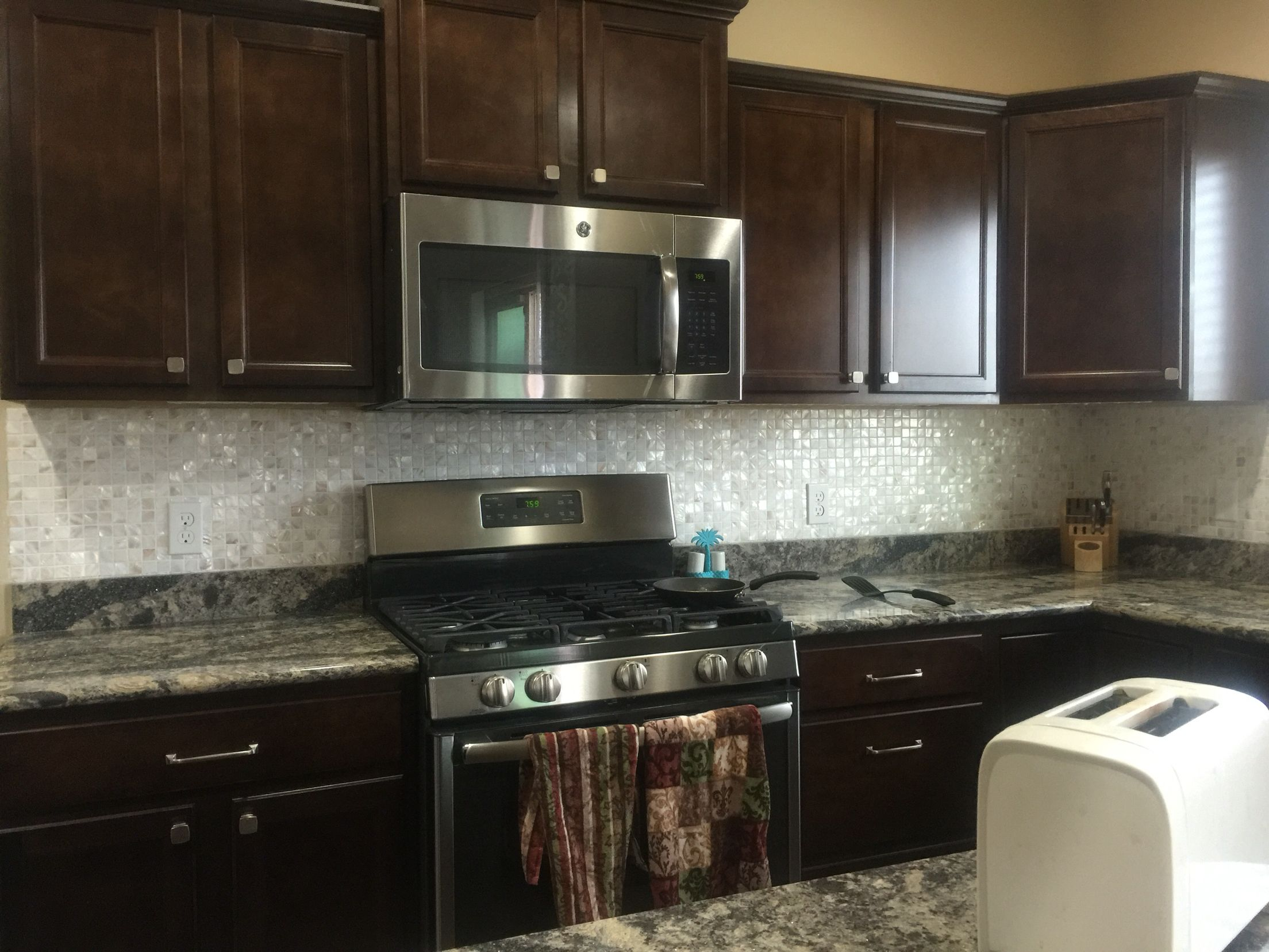dark cabinets and dyi mother of pearl kitchen backsplash