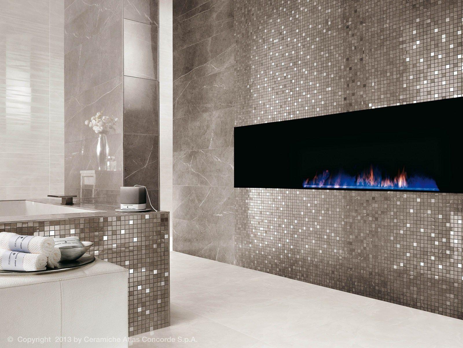 Rivestimento in ceramica a pasta bianca effetto marmo for Rivestimento parete soggiorno