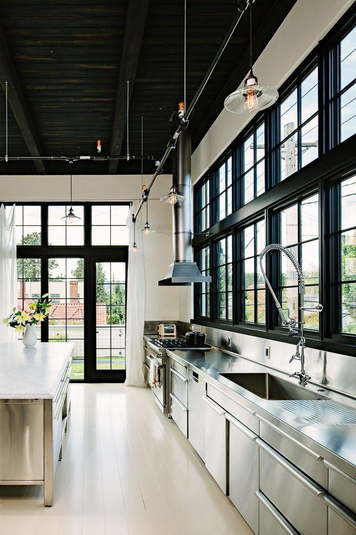 Straight kitchen building under windows with a