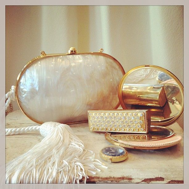 …and she had a presence that sung subtle notes of femininity: Glam out with a beautiful Judith Leiber mother of pearl clutch and some chic, sparkly make-up.