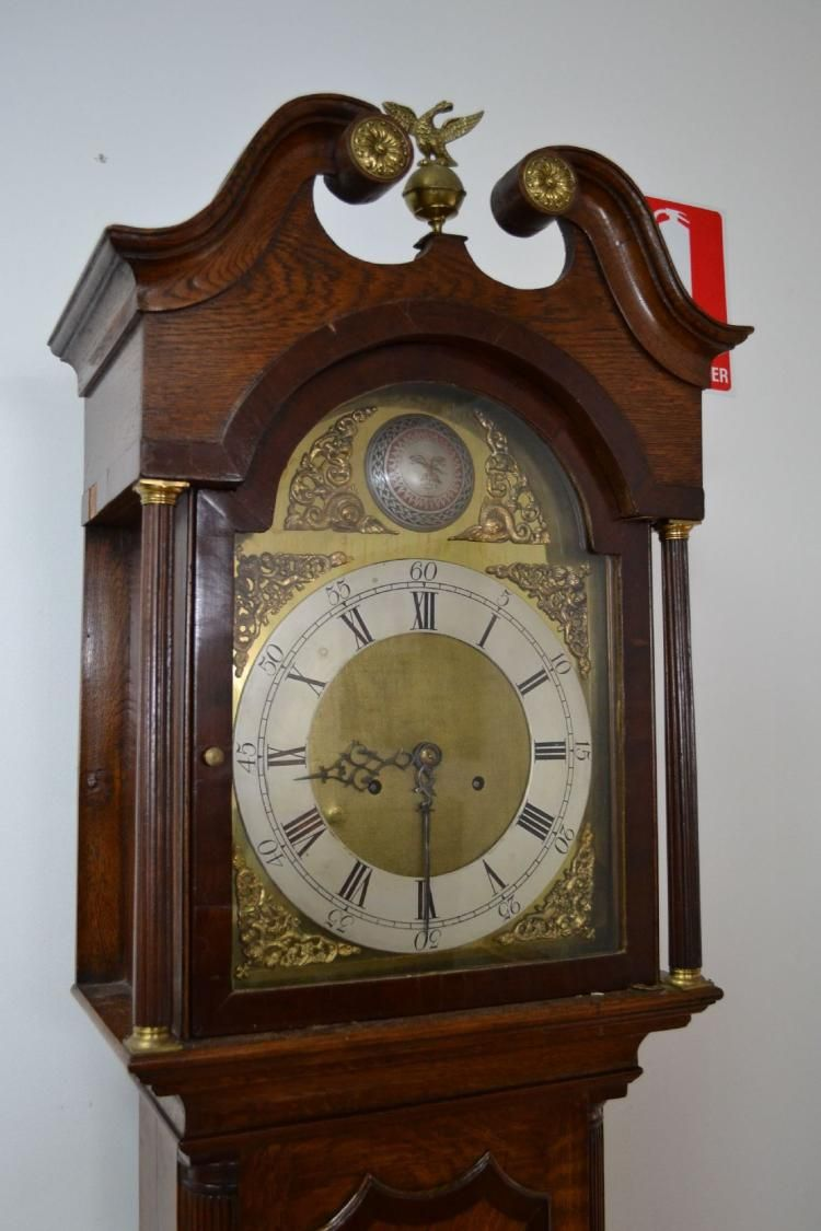 English oak longcase clock, mahogany banded oak case and hood, eight day movement, arched brass dial with silvered chapter ring, roman numeral