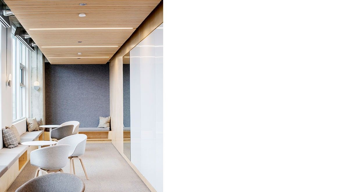 In A Cafe Space Neutral Maple Walls Contrast A Series Of House Shaped Booths Lined In 3mm Wool Design Felt In A B In 2020 Lounge Areas Wall Coverings Workplace Design