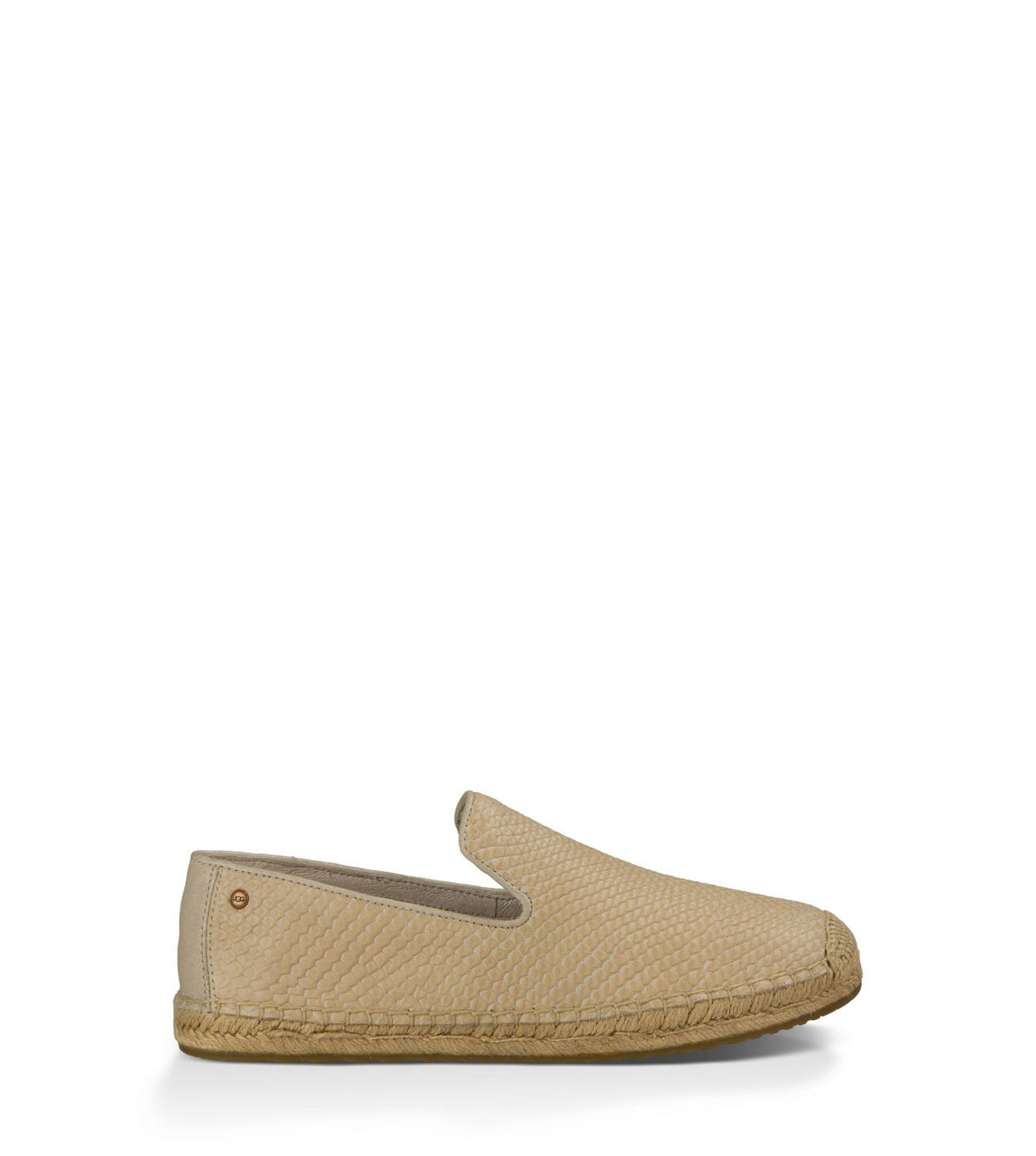 The classic espadrille has an exotic new look and UGG® comfort. Lightweight and perfect for warmer weather, the Sandrinne Snake features soft leather with embossed scales, a hand-constructed jute sole, and a soothing sheepskin heel counter lining.