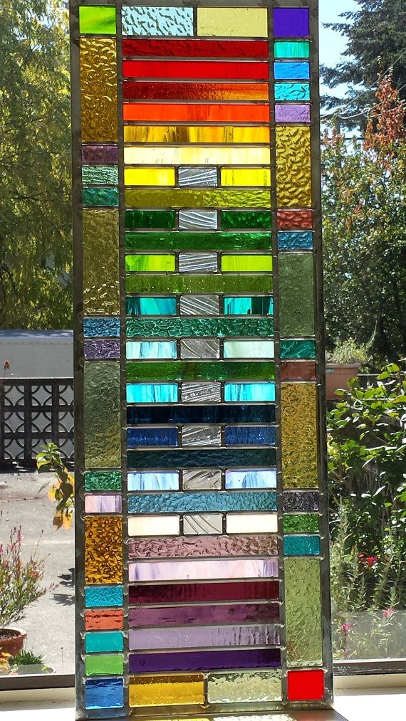 34 by 12 inches approximately.  I designed and built this original stained glass window using the traditional lead came technique. It is strong and durable and should last many decades. It has a sturdy zinc border came with hooks on both sides so that it can hang horizontally or vertically. I used high quality stained art glass.  If you want something right away check out my, Ready to Ship Now shop section. I can ship the items I have on hand within 2 days, otherwise please allow 3 weeks…