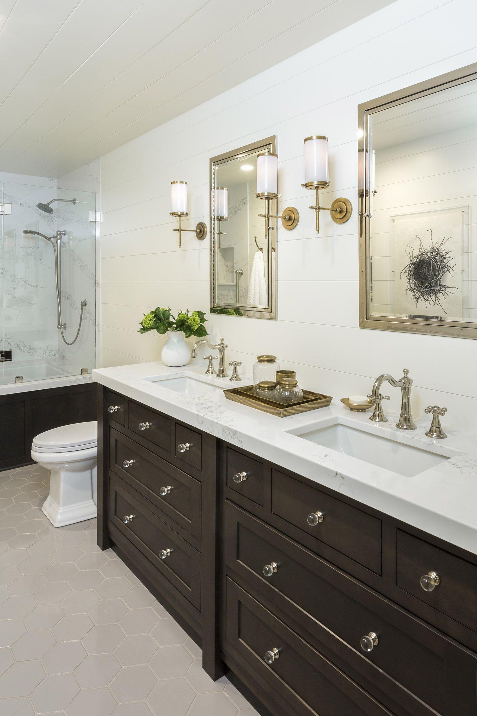 Hall bathroom with dark furniture style vanity, hex tile floor and ...