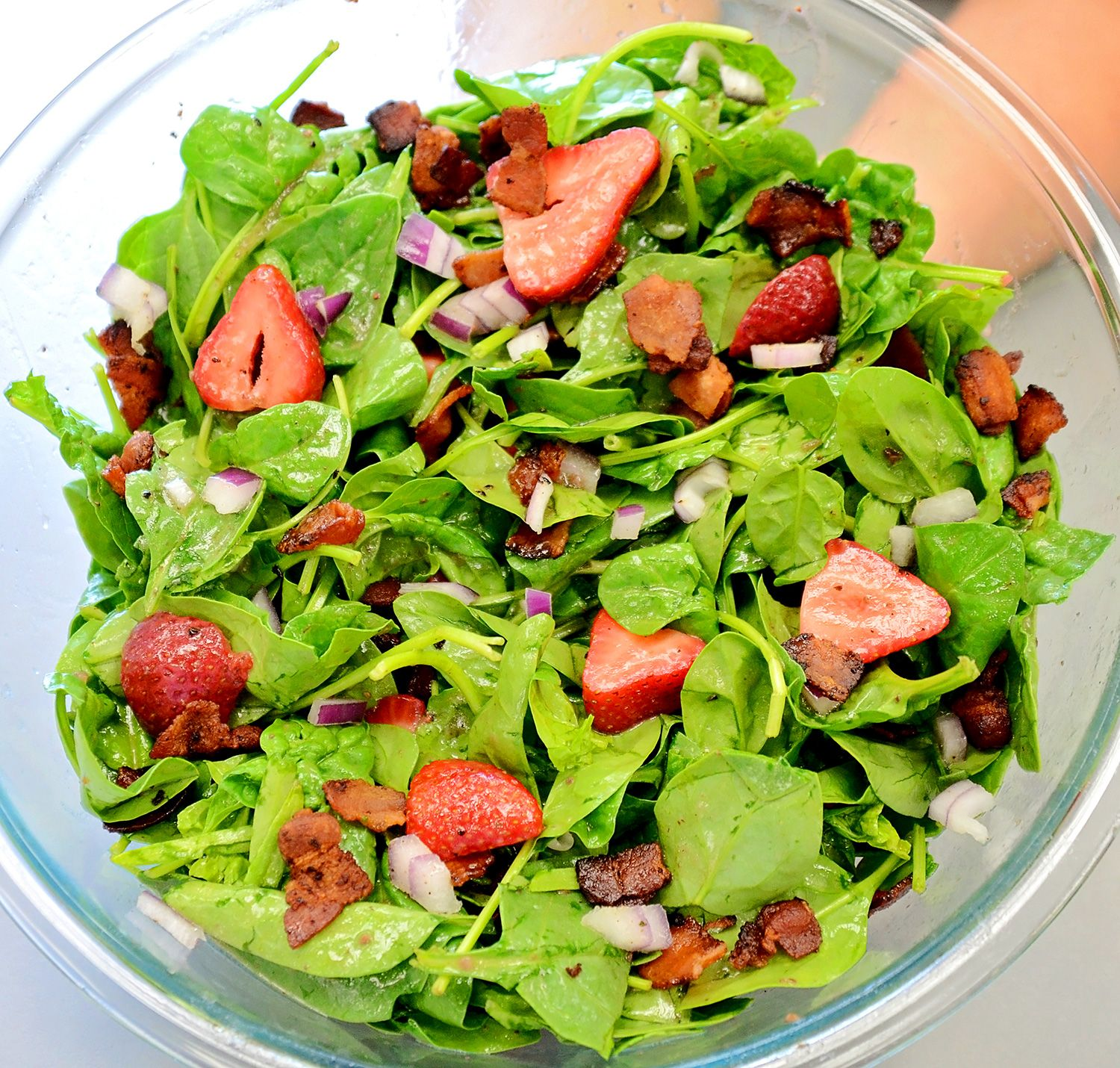 Simple Spinach Salad: Fresh organic spinach, sliced organic strawberries, chopped red onion, crispy fried bacon, toasted pecans. Top with Newman's Own Raspberry & Walnut Vinaigrette. Mix together and enjoy!