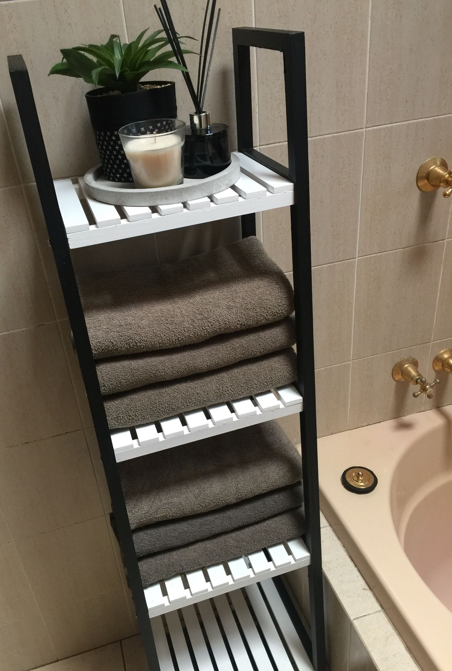Kmart hack bathroom caddy shelves painted black and white to make it