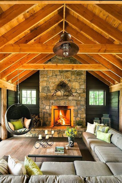 Simple, but dramatic. Love the honey colored ceilings and dark walls. Keeps it from having too much of the same wood color too often seen in some rustic homes.