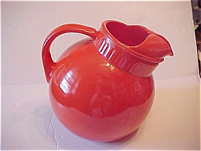 Fire King Rainbow Ball Jug 2 quart. Tangerine. Click on the image for more information.