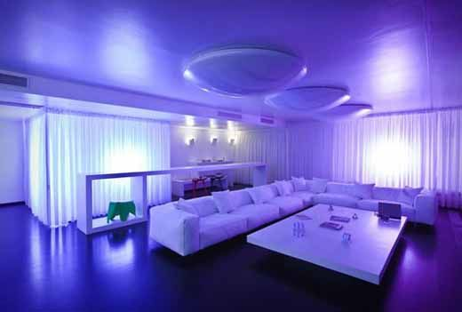 A Room Decked Out In White With An Led Lighting Concept That Can Change The Color