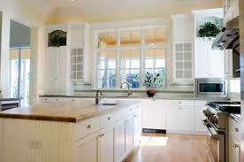 Bright & warm kitchen. will allow me to have the darker rustic tables
