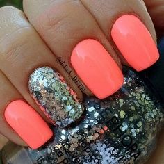 coral nails with silver sparkles.
