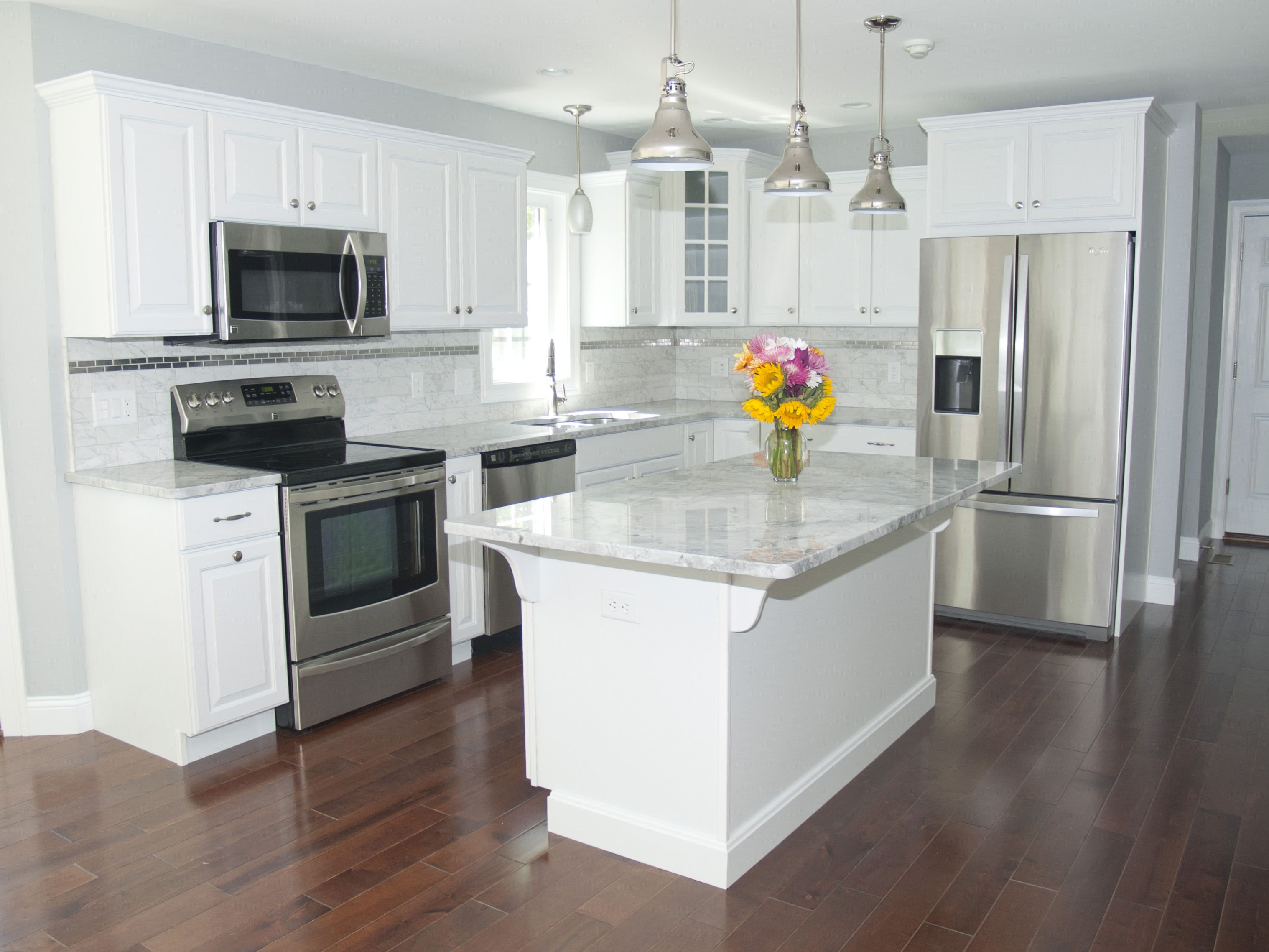 stainless kitchen ikea table set gorgeous modern with white cabinets steel appliances pendant lighting over the island we love subwaytile these