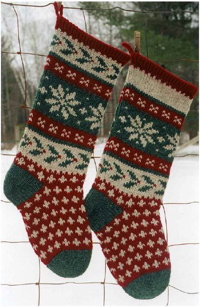 A lovely handknitted Christmas stocking in a poinsettia and holly ...