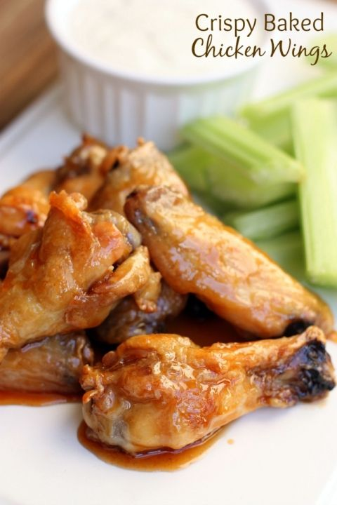 Crispy Baked Chicken Wings in a delicious sweet and spicy sauce! Recipe on TastesBetterFromScratch.com