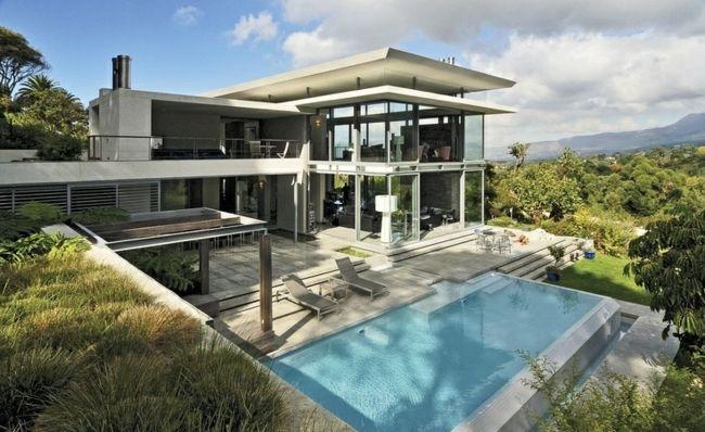 poolhaus schwimmbecken beton infinity pool haus wald bauen