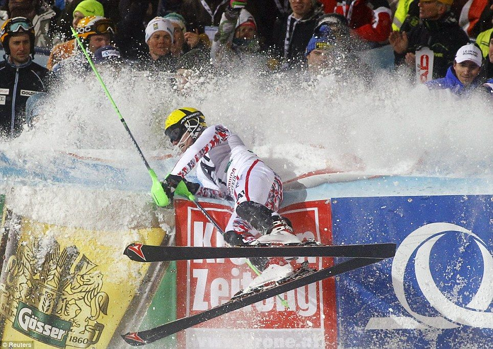 Marcel Hirscher needs a little help to stop.