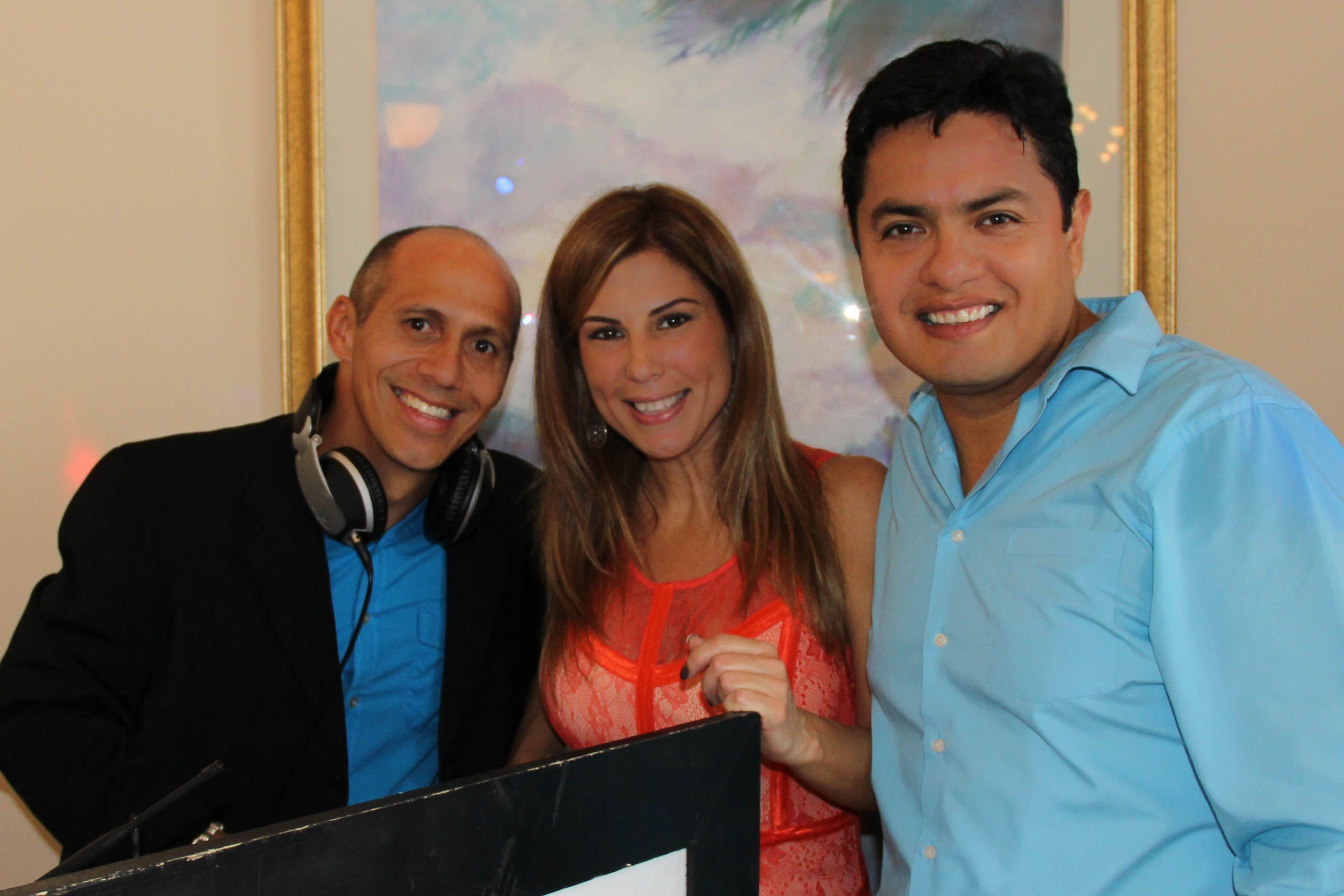 DJ Jorge and Photographer Cesar Nunez.  Photographer donated his work to the school's Autism department.
