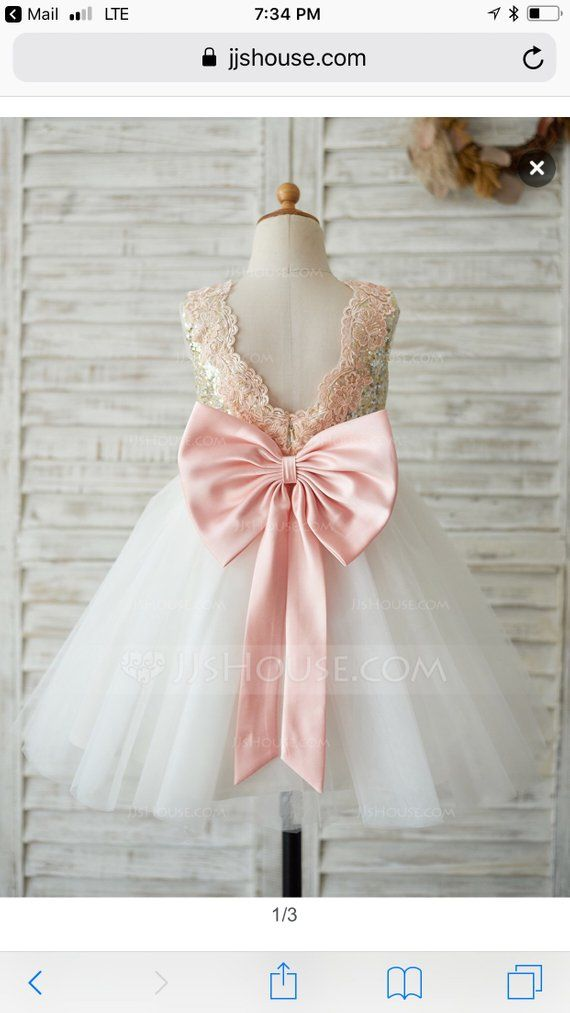 904376c3a6f Flower girl dress Size 7. Rose Gold   Gold Sequin with a white tutu tulle  skirt. Pink satin bow. Bra